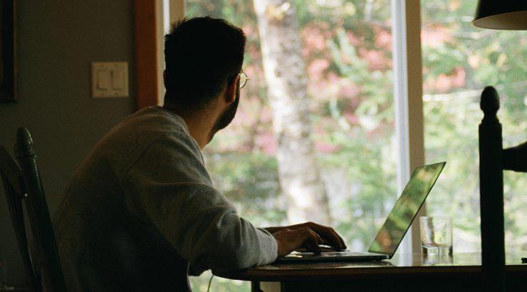 Man looking outside window photograph