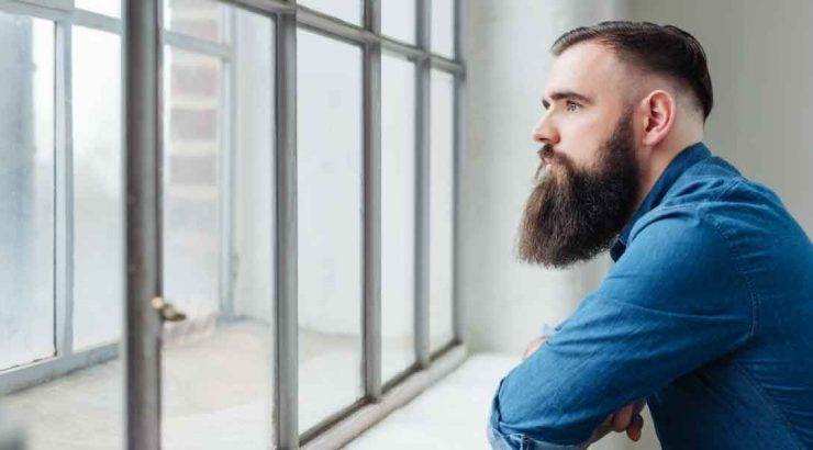 Image of man looking out of window