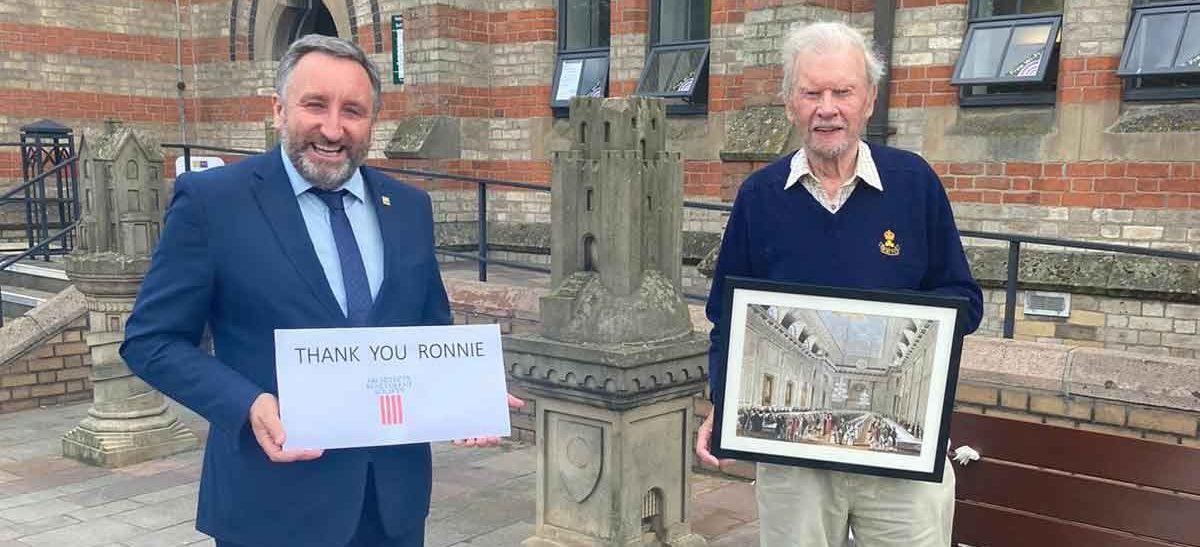 Eddie Weir Presents Ronnie With Frame